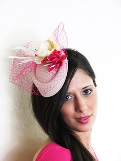 Hey, I found this really awesome Etsy listing at https://www.etsy.com/listing/97216778/cream-ivory-fascinator-with-fuchsia-veil