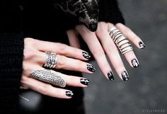 Stunning rings. Finger armour, black nails.