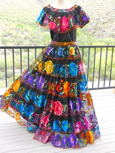Outrageous Mexican Skirt and Blouse from Chiapas worn at Festivals...the Brightly Colored Flowers and Designs are Hand Embroidered with a