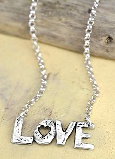 Love the LOVE necklace!  #necklace #jewelry #handmadejewelry #romanticjewelry #cowgirljewelry #love #necklaces #handcrafted  islandcowgirl.com