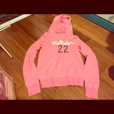 "Hollister Pink Hoodie Comfy, pink pullover hoodie. Great condition- no stains or tears. Size is L but if you don't know this brand, they run small. So this really fits more like a small or medium. (Hint: I am 5'4"" and 130 lbs, normal length torso). Getting rid of bc my new place has very little closet space. Plus #22 is the best Hollister Tops Sweatshirts & Hoodies"