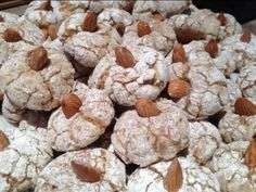 """Soft Almond Cookies 6 c. ground almonds 5 eggs 2 c. sugar 1.5 TBS almond extract powdered sugar Mix almonds & sugar. Add eggs; mix. Add extract; mix. Form 1/2"""" balls & roll in powdered sugar. Top w/ nut & place on cookie sheet. Bake 8-10 minutes @ 350."""