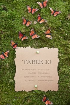 """[""""Hearts a Flutter"""" wedding invitation inspiration] Butterfiles and moss make an interesting, enchanted tablescape."""