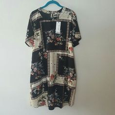 Boohoo Plus NWT floral romantic boho dress 16 US NWT from Boohoo Plus, size 16 US shift dress with crew neck, side pockets, keyhole and button opening in the back, short sleeves. Beautiful floral pattern on black and ivory background with paisley border. Romantic bohemian feel. Lightweight flowy fabric.  I *live* in these Boohoo dresses and accidentally made a double order online. I would rather keep this as a backup than sell for lower than listed so please no lower offers on this item…