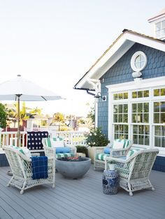 See dozens of photos of a wonderful beachy home with bold accents on the California coast! It's the 2014 Coastal Living Showhouse, designed by Betsy Burnham of Los Angeles. Here's an open deck.