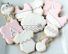 Listing is for one dozen (12) Chevron/Polka Dot Baby Cookies (Colors can be customized) **Name Plaque Cookie can be purchased for an additional fee** You will receive: 4 Onesie Cookies 4 Plaque Cookies with initial (please leave initial choice during checkout) 2 Rattles 2 Bibs Cookies are decorated in royal icing and hand painted with silver luster dust. DATE NEEDED: Please leave your event date in note to seller during checkout. ********************************************************...