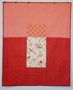 Birds in apricot crib quilt - front.