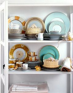 love all of these sets of plates!!  gold and turq love!