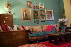 Bohemian Style living room with gallery art wall. Great wall color. Décor / Style