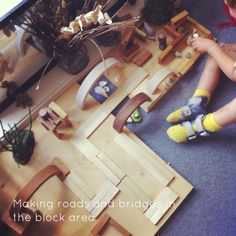 {from An Everyday Story} A mirror in the block corner with natural materials.