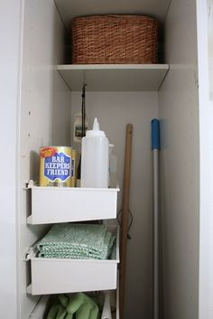 Organizing a small laundry room cupboard.