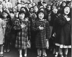 Immigrant children saying the Pledge of Allegiance shortly before Japanese Americans were placed in internment camps. Dorthea Lange.