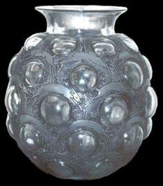 Antelopes, Globular shaped vase with short Straight neck. Translucent with repeated pattern of etched and frosted antelopes interspersed with clear half bubbles .