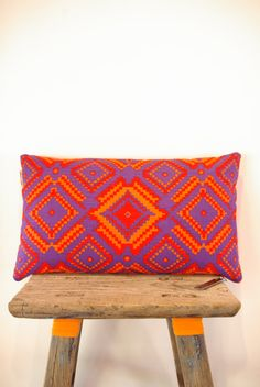 Bright geometric throw pillow