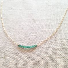 This is a genuine Emerald necklace. The Emerald necklace is made of gold filled chain and real Emerald gemstone. This green necklace is great for layering with other necklaces. This Emerald jewelry is great to go with everyday outfit. Emerald is May birthstone. This delicate necklace can be a great gift for people who were born in May. The size of the Emerald bead is 1.5mm. The Emerald beads I use are real and all natural without treatment. The opaque ones you see in the market are treated…