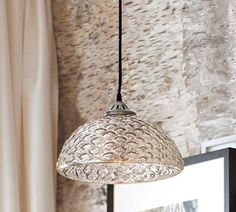 """Reminiscent of the hobnail glass made popular in the 1930s, our pendant has an ornate, corrugated texture and is hand finished in warm Antique Silver.  11.5"""" diameter, 6"""" high  Crafted of hand-blown glass.  Cloth cord.  $99"""
