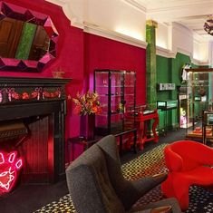 The Emerald & Ruby Rooms, Painted fireplace's & Malachite & gilded pilasters by Timna Woollard Studio for Solange Azagury-Partridge's Mayfair Jewellery shop London image © Solange Azagury-Partridge, solange.co.uk
