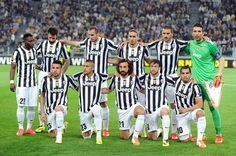 Juventus players line up for a team photo before the start of the UEFA Europa League quarter final match between Juventus and Olympique Lyon...