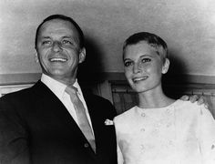 . Frank Sinatra and Mia Farrow smiles fondly outside the Sands Hotel suite where…
