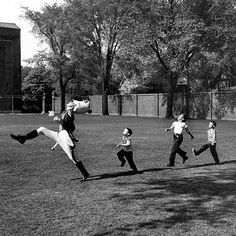 The drum major for the University of Michigan marching band rehearses as admiring children fall in line, 1950. (Alfred Eisenstaedt—Time & Life Pictures/Getty Images) by life
