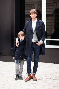 You'll be surprised at how easy it is for any gentleman to throw together this casually classy outfit. Just a navy overcoat paired with navy jeans. Brown leather casual boots round off this ensemble very well. Daddy And Son, Father And Son, Dad Son, Future Husband, Navy Overcoat, Navy Coat, Herren Outfit, Inspiration Mode, Well Dressed Men