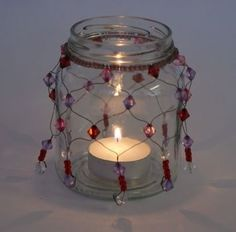 A beaded candle light jar . Free tutorial with pictures on how to make a lantern in under 60 minutes by beading and glassworking with beads, wire, and candle. Garden Lanterns, Candle Lanterns, Candle Jars, Candle Holders, Mason Jar Crafts, Mason Jars, Canning Jars, Baby Food Jars, Jar Lights