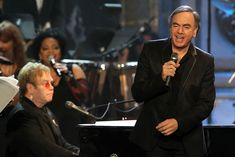 With Elton John  Elton John and Neil Diamond perform during the 26th Annual Rock and Roll Hall of Fame Induction Ceremony at the Waldorf-Astoria in New York on March 14th, 2011