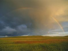 The sky dominates Nebraska's prairie landscape—and provides the perfect canvas for some awe-inspiring rainbows.