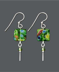 Get glam with bright green glass. What better way to spice up your ensemble than to add bold color. These Jody Coyote earrings feature assorted green glass square drops, stick drop charms, and green g