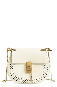 Obsessing over this gorgeous white crossbody with gold hardware for a chic and feminine style. This gem is definitely at the top of the wish list.