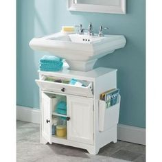 Developed only for Hammacher Schlemmer, this pedestal sink storage cabinet surrounds the sink base to provide extra under sink storage and organization. Pedestal Sink Storage, Under Sink Storage, Small Storage, Storage Ideas, Organization Ideas, Storage Baskets, Kitchen Storage, Diy Storage, Closet Organization