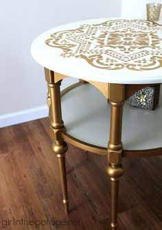 A stunning stenciled table makeover in metallic gold and white for Themed Furniture Makeover Day.   http://girlinthegarage.net