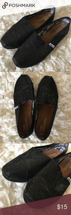 """TOMS Classic Glitter Slip On Sparkly black TOMS. """"One for one"""" lining. Almost like new except for red marks on bottoms. Youth size 3.5 which fits a women's 5. Thanks for looking!          ***Buy any two items get one $5 item FREE. Limited time. Happy shopping!*** Toms Shoes Flats & Loafers"""