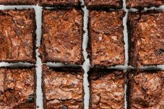 Dark, fudgy, gooey bars of chewy delicious brownies. They're so gooey and rich. Did I mention gooey?