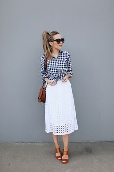 knot your button down shirt with a midi skirt for a cute, summery look