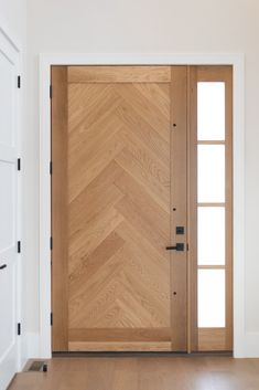 Custom built herringbone oak front door with matte black hardware for this modern farmhouse style custom home. Photographer: Made with Michelle Modern Exterior Doors, Wood Exterior Door, Exterior Front Doors, Modern Farmhouse Exterior, Modern Farmhouse Style, White Wooden Doors, Internal Wooden Doors, Contemporary Front Doors, Modern Front Door
