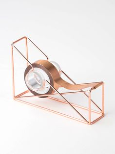 Give your office an authentic, sophisticated feel with the Copper Wire Tape Dispenser. With its copper wire construction that can fit infinite color palettes, this tape dispenser gives your desk a unique touch while keeping your stuff organized. Rose Gold Room Decor, Rose Gold Rooms, Cool School Supplies, Office Supplies, Gold Everything, Gold Office, Cute Stationary, Tape Dispenser, Cute Room Decor