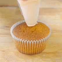 gif image demonstrates how to ice a cupcake