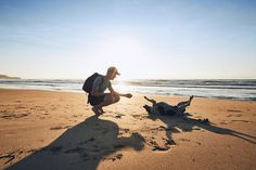 Young man with dog on beach by Chalabala #ErnstStrasser #SriLanka