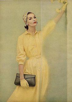 Georgia Hamilton wearing a yellow cotton shirtdress, 1955