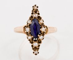 Antique Ring - Antique 1880s 14k Rose Gold Navette Sapphire & Seed Pearl Ring by TheCopperCanary on Etsy https://www.etsy.com/listing/384796116/antique-ring-antique-1880s-14k-rose-gold