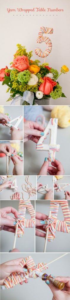 diy yarn wrapped table numbers for wedding table decoration ideas