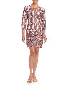 """<ul> <li>A slinky stretch-knit dress in a striking, ethnic print</li>  <li>V-neck</li>  <li>Front crisscross-tie detail</li>  <li>Three-quarter-length sleeves</li>  <li>Partially lined</li>  <li>About 35"""" from shoulders to hem</li>  <li>Polyester/spandex</li>  <li>Hand wash</li>  <li>Imported</li> <li>This item will arrive with a tag attached and instructions for removal. Once tag is removed, this item cannot be returned.</li></ul>"""