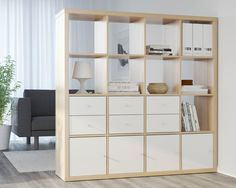 """KALLAX Shelf, $109 These cool cubes come in many size variations, but this one in particular makes for a great room divider in studio apartments. And here's a smart hack: """"Put bins or doors on certain cubes for extra privacy,"""" says Simonsen"""