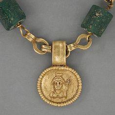 "(DETAIL OF PENDANT Gold necklace with medallion depicting a Goddess, Roman Period (30 BC-300AD), gold & green glass, 17.25"" long. Egypt"