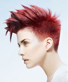A short red straight coloured spikey Womens haircut hairstyle by Tommys Hair Company