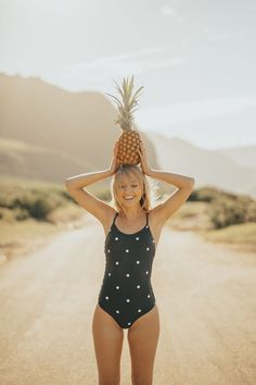SHOP! The Classic One-Piece in black with white polka dots is a chic and sassy piece to add to your swimsuit collection. Featuring an elegant low back and long, adjustable straps to give you the ability to customize the length for the perfect fit. This modest one piece is fun, flirty and features old school polka dots and some boho vibes in back. #swimsuit #swimwear #swim #summer #onepieceswimsuits #modestswimsuits #swimsuitsforteens #swimsuitsformoms