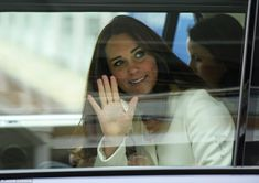 On her way: The Duchess of Cambridge waved happily to the crowds as she was driven away an...