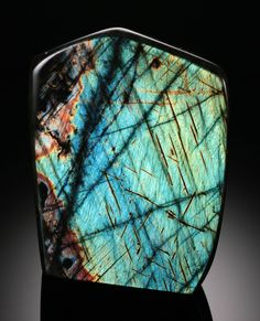 Labradorite : STONE OF TRANSFORMATION AND MAGIC.  CLEARS, BALANCES AND PROTECTS THE AURA. PROVIDES CLARITY AND INSIGHT. CALMS STRESS AND ANXIETY. STRENGTHENS INTUITIVE CONNECTION, PSYCHIC  DEVELOPMENT AND SPIRITUAL WISDOM. HEALS SUBCONSCIOUS ISSUES. HELPFUL TO EYESIGHT, DIGESTION, BRAIN FUNCTION, METABOLISM. ASSOCIATED WITH SOLAR PLEXUS AND BROW CHAKRAS.