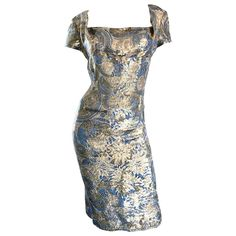 1950s Peggy Barton Couture Larger Size Gold   Blue Silk Brocade 50s Wiggle Dress   From a collection of rare vintage evening dresses and gowns at https://www.1stdibs.com/fashion/clothing/evening-dresses/